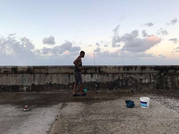 Havana, Cuba a fisherman along the malecon
