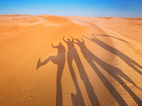 Morocco group travel tour sand silhouettes