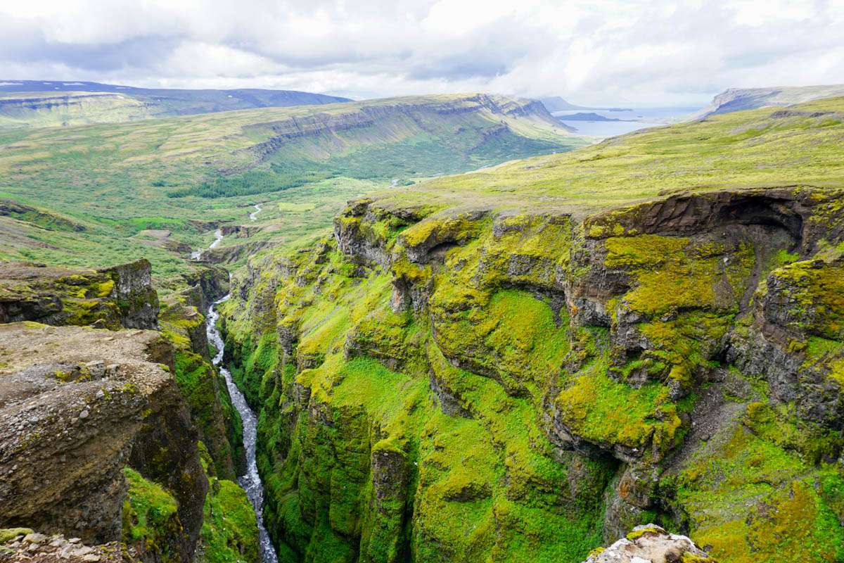 Top of Glymur waterfall in summer Iceland