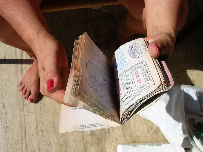 person holding passport open