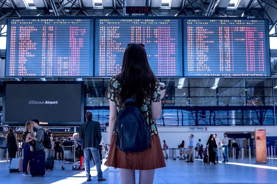 woman at airport flight schedules