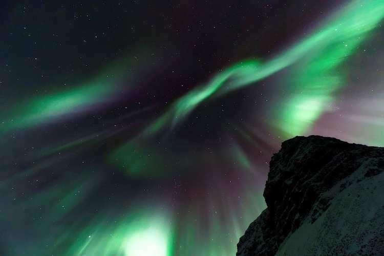 Purple green auroras