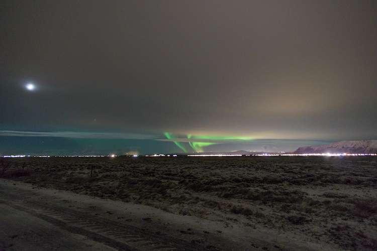 auroras behind clouds