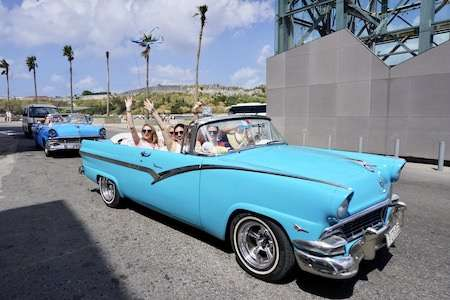 Cruising in classic cars in Cuba with the group