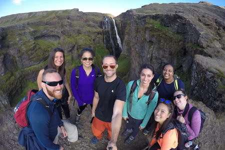 group selfie in Iceland in front of Glymur waterfall