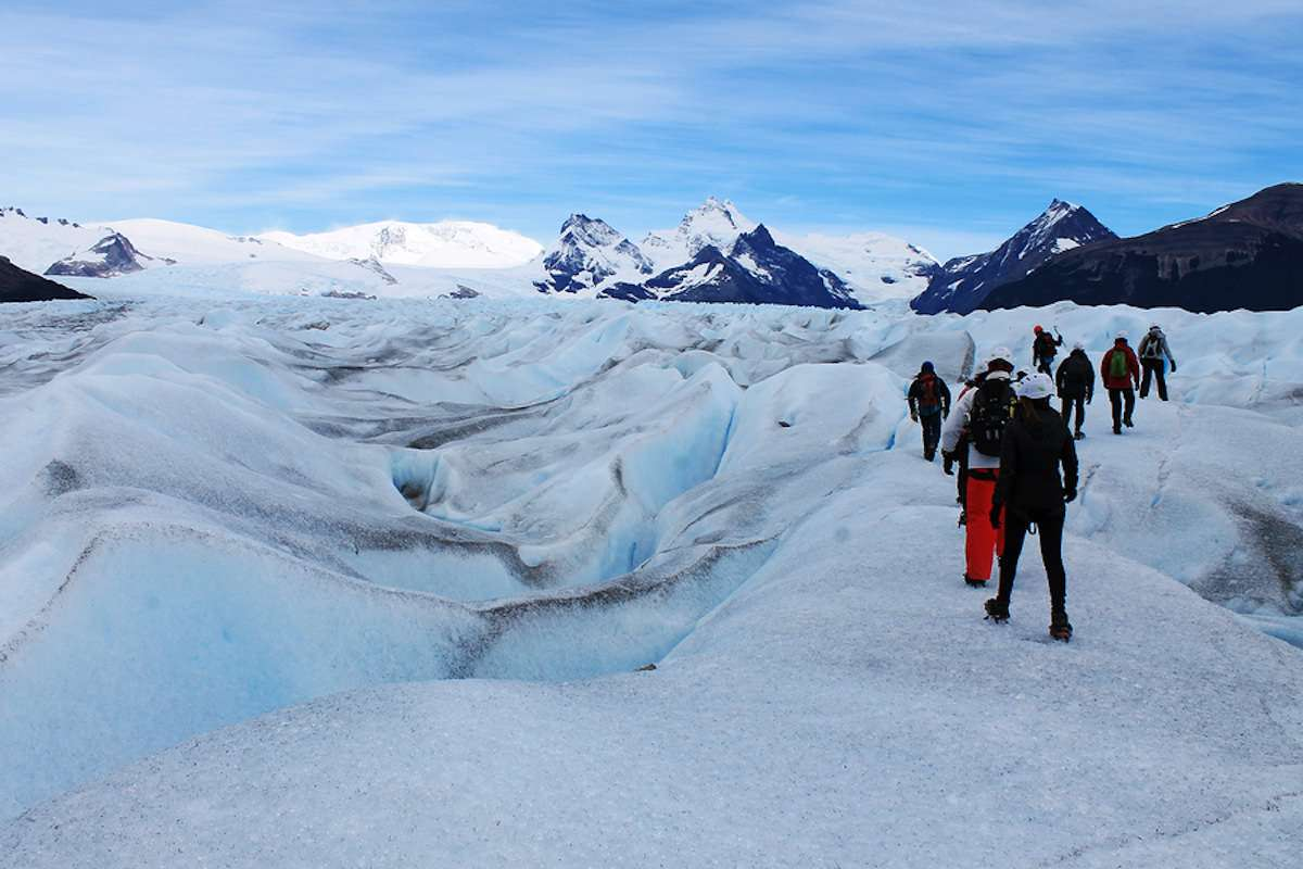 young adult group hiking on a glacier