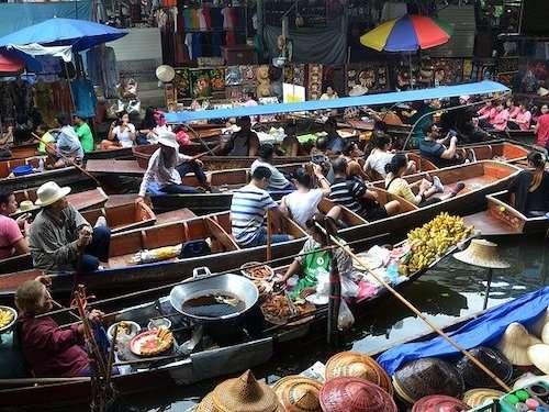 Boating through floating market Thailand group travel