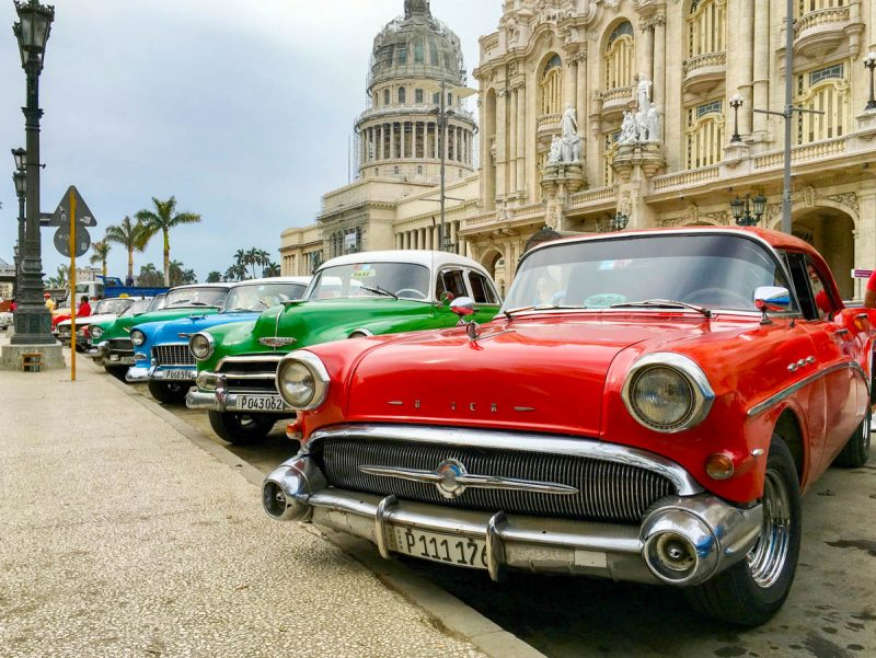 Classic cars by the capitol building in Havana